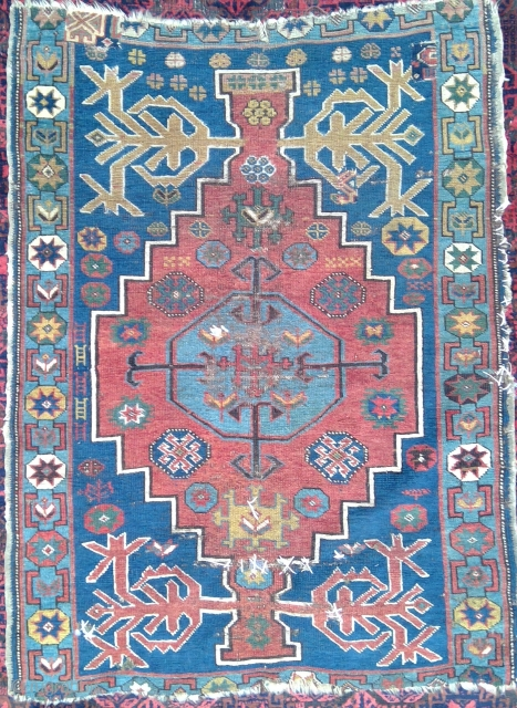 Antique Avar Medallion Rug, 35 x 46 inches. Ravaged, slashed, stabbed,sewn and patched, this old baby is still kickin'.