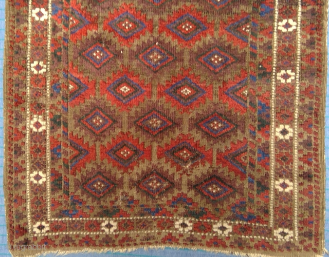 B-021 Antique Baluch rug with 33 ashik-like guls, 30 x 49 inches. Plummy aubergine, deep sea green, auburn and crimson shades of madder stars aglow sculpted on dramatically corroded brown field. Beauty  ...