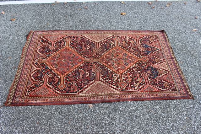 South Persian late 19th century 3'7'' x 6'0''.  Probably Khamseh.  Pile is worn low and even.  Slightly irregularly shaped with one end about two inches wider than the other.  ...