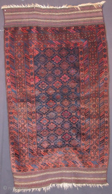 antique Baluch rug, Northest Peersian (Khorrosan), silky lustrous wool that shines. Good complete condition. There is cochineal in this piece along with three very small highlights with fuchsine  in the striped  ...