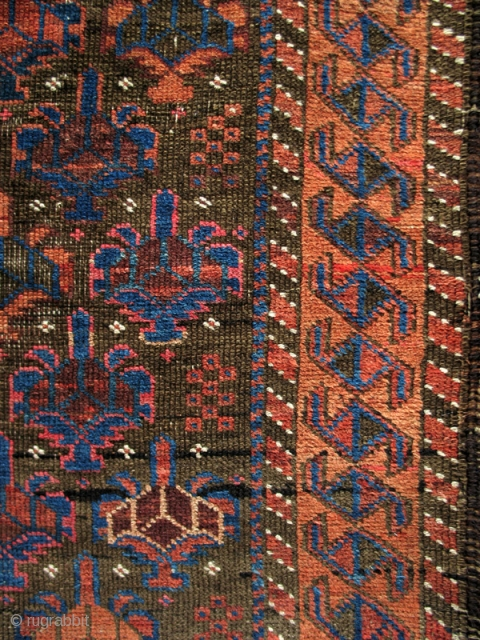 """Symmetrically knotted Baluch rug, of the type now often called Bahluli. Very good color on a brown ground with Dokhtar-i Gazi shrubs and a border often seen in some Turkmen rugs. (3'9"""" x  ..."""