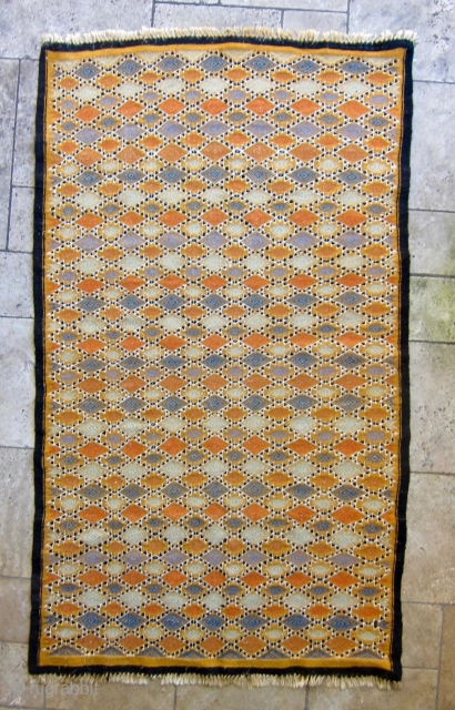 Mergoum - flatweave kilim rug from Southern Tunisia, Gouvernement Tataouine. Late 20th century. Vibrant combination of mainly vegetable dyed wool, some synthetic dyed wool in the embroidery, and undyed black wool. Cotton  ...