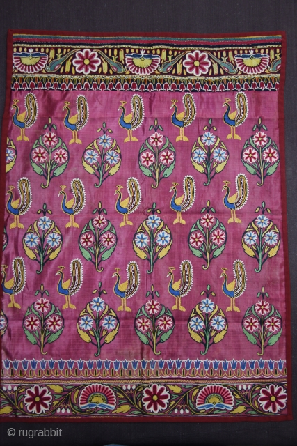 A fine piece of Mochi embroidery textile on maroon satin silk decorated with typical peacock and floral motifs.