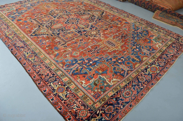Music for the eyes circa 1920's Heriz area rug  Beautiful natural colors aproximately 370 x 260 centimeters. good pile some low spots