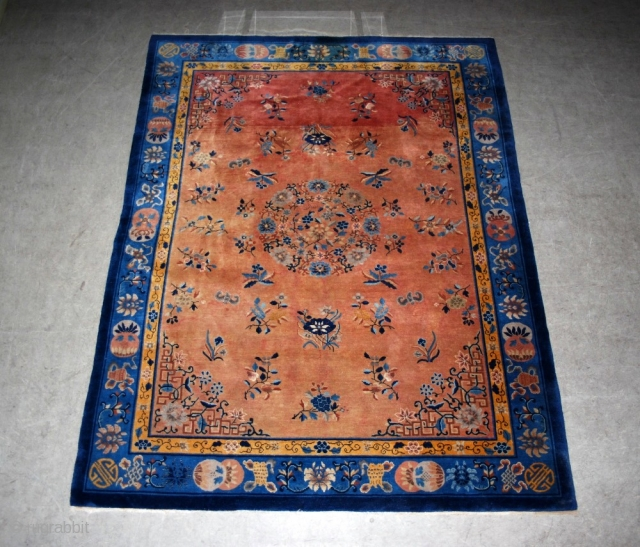Antique Chinese carpet. Profusely decorated with bats, butterflies and urns. Unusual colour. Lovely condition. 330 x 250 cm.