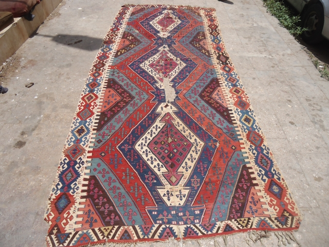 "Large Colorful early Anatolian Kilim with some condition issues,great natural colors as found without any work done.Size 13'4""*5'6"".E.mail for more info and pics."