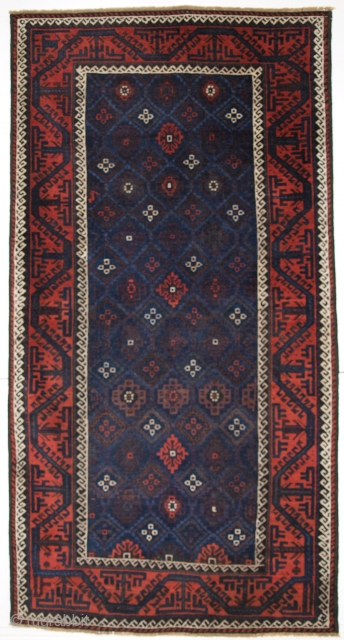 ANTIQUE BALUCH RUG WITH LATTICE DESIGN IN SUPERB BLUES, BOAT BORDER, LATE 19TH CENTURY.