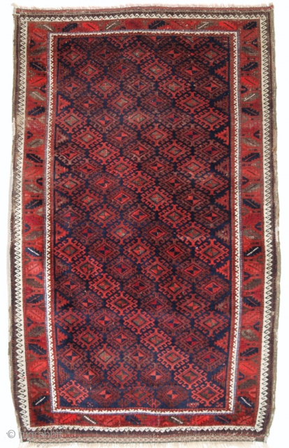 Antique Baluch rug with lattice design, unusually large rug size, full pile with corrosion to the olive brown, superb soft glossy wool, original end finishes with weft work. Size: 211 x 129cm.