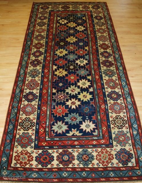 Antique Caucasian Talish long rug with all over star design. www.knightsantiques.co.uk  Mid 19th century.  Size: 8ft 6in x 3ft 6in (260 x 107cm).  A superb example of a Talish long rug, multi coloured stars on  ...