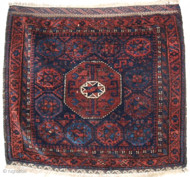 Antique Baluch saddle bag face with 'star in octagon' design of scarce small size.