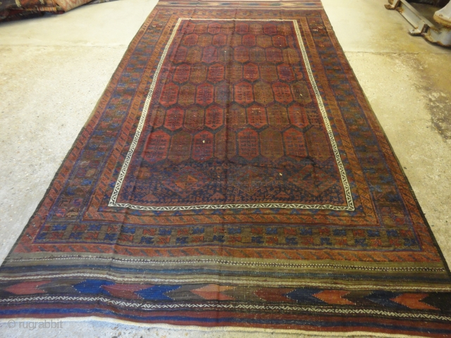Interesting Afghan Baluch main carpet, note the change in field design. Very long kilim ends. Size: 370 x 200cm.