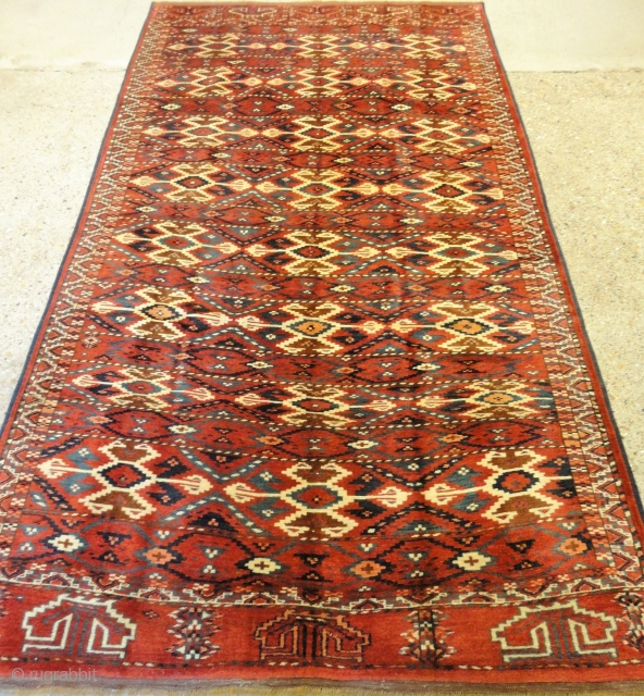 Interesting Yomut carpet of small size, unusual design with great colour. Size:  256 x 140cm.