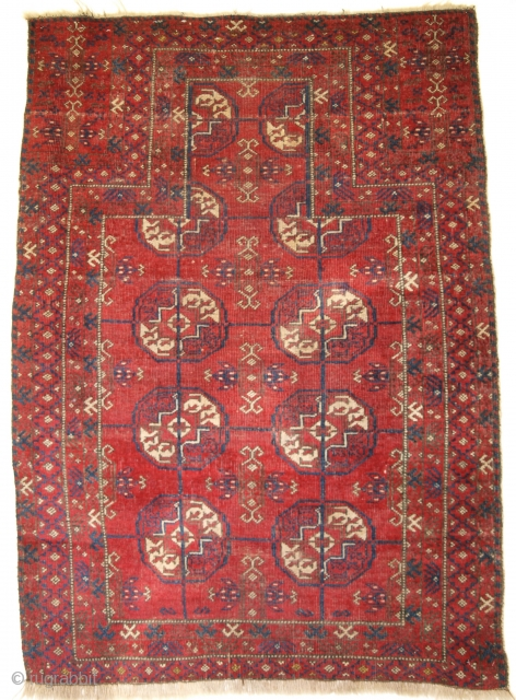 A rare prayer rug by the Sarakh Baluch, Turkmen gul design, not how the top two guls are disappearing behind the mihrab. Size: 126 x 86cm.