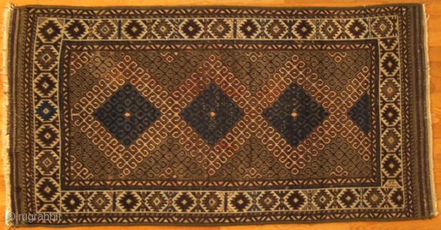 Persian Baluch, c.1900. 3 x 4½ ft (900 x 1350 cm), fair condition.