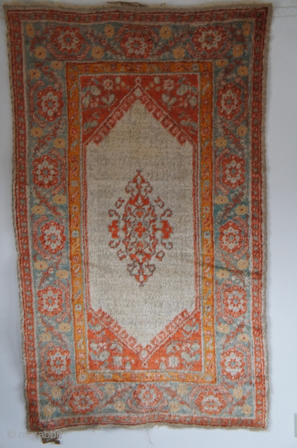 "Angora Oushak rug. Ca. 1900. 3'10' x 6'4"". This is even softer than in the photo which was taken without a flash to reduce glare from the shiny surface. The ends and  ..."