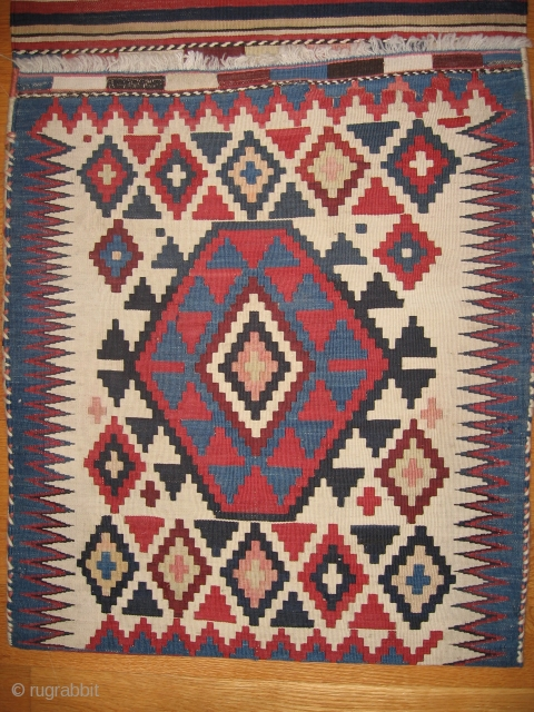 "This nice pair of Kilim bags date about 1900. It has rewoven loop holes and new binding on the sides. The measurements are 59"" x 20"". These are very striking when  ..."