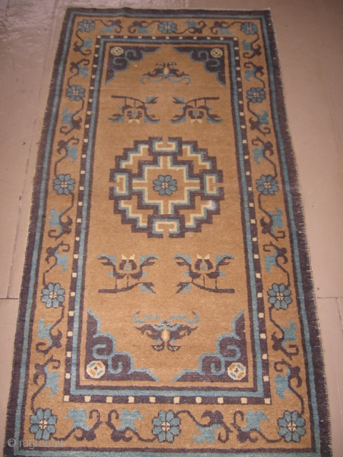 "This chinese rug probably dates 1900-1920. The darker purple-blue is slightly corroded in the corners otherwise the rug is in generally good pile. It measures 3' x 5'9""."