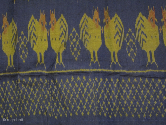 A weft ikat silk tube skirt from Northeastern Thailand with lovely repeating series of double facing chickens on the lower half while the upper part adorned with series of graphical bouquet motif.All  ...