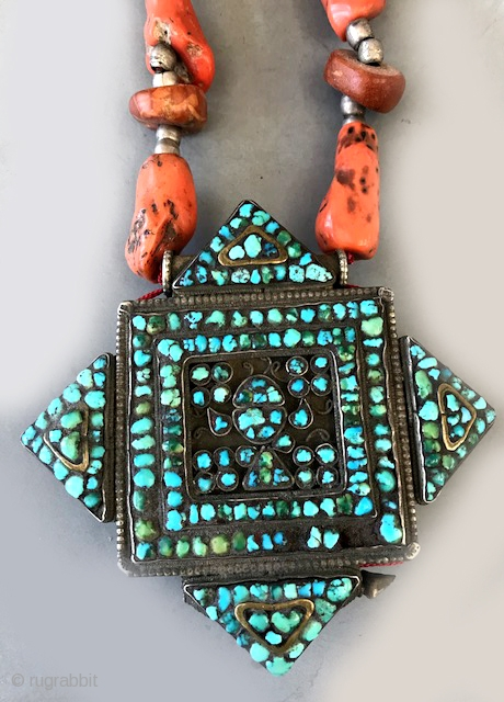 Tibetan gau , turquoise and silver strung with coral, amber , silver beads as a designed necklace , done in the 70's as a wearable. Coral, amber from Algeria and Morocco.