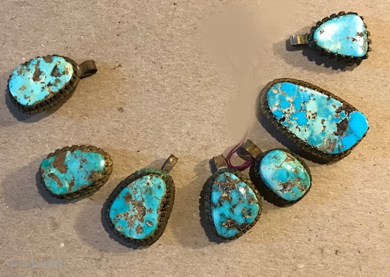 Collection of turquoise necklace components from Nadj area of Saudia Arabia silver bezels.
