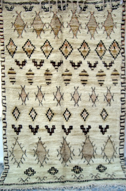 MOROCCAN MIDDLE ATLAS BERBER RUG which falls under the Beni Ourain group and is probably the work of the Ait Youssi tribe. It has silky undyed wool and delicate highlights of most  ...