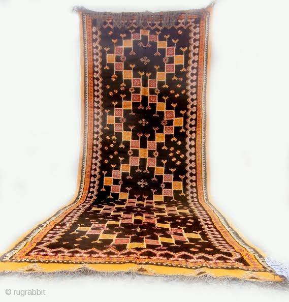 MOROCCAN BERBER HIGH ATLAS CARPET from the Ait Zenaga Berber tribe. Although the deep field color is typical of Ait Zenaga weaving the rest of the colors and design are most unusual  ...