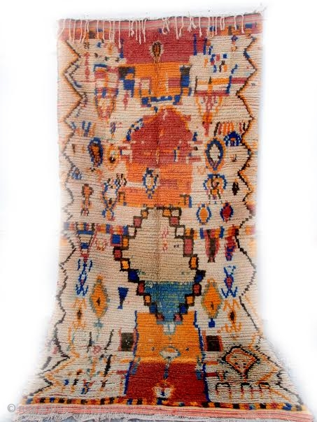 MOROCCAN BERBER RUG FROM BOUJAD. Even the Berbers of the rest of Morocco regard the weavers from Boujad in the Middle Atlas as eccentric. They adhere only to the rare, unplanned, spontaneous,  ...