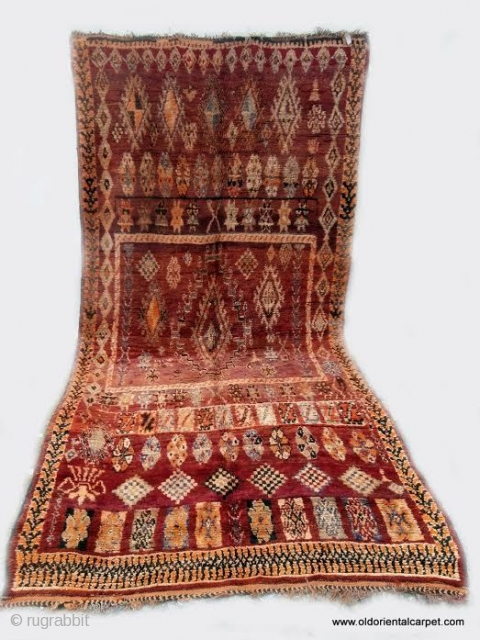 MORROCAN BERBER MIDDLE ATLAS CARPET. A large carpet from the region of Boujad which, unusually for this origin, has a well balanced overall design in which chestnut shades predominate. Other colours are  ...