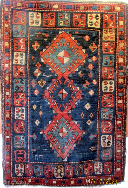 ANTIQUE PRE - SOVIET CAUCASIAN RUG from the region of Zakatal, a group of villages in north west Azerbaijan. The region is bordered to the north and east by Dagestan and to  ...