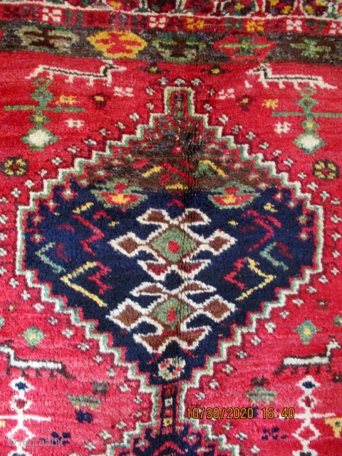 OLD LURI TRIBAL RUG from the Zagros Mountain region of southern Persia. The three medallions are surrounded by a random scattering of plants, flowers, bushes, birds and wild animals. The rug  ...