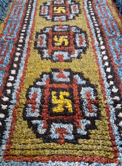 Old Tibetan Wangden rug, khaden size (circa 175 by 90 cm, fringes included), powerful three medaillon with bright yellow swastikas design, unusual brillant colors with rare green field, good age, genuine and  ...
