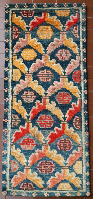 Very nice old Tibetan rug, very early 1900, very pleasant colors, very nice and soft wool, very unusual small size (circa 113 by 49 cm), very good condition (no repairs, full pile),  ...