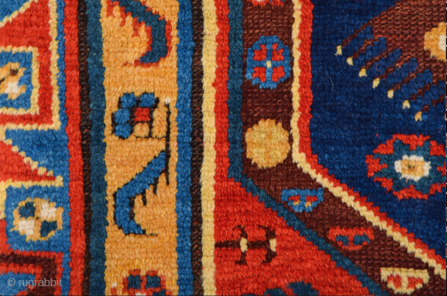 The golden yellow field of this classic Megri is divided into one section by one blue-ground vertical design bar containing tree forms. The light and warm palette is a typical feature of  ...