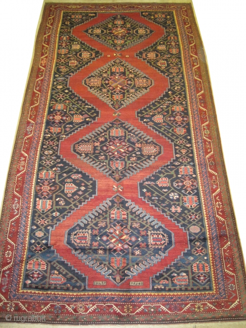 """Karabagh Caucasian dated 1320 = 1902 antique, collectors item.  383 x 195 (cm) 12' 7"""" x 6' 5""""  carpet ID: W-113  High pile, indigo background in perfect condition.    A similar example  ..."""