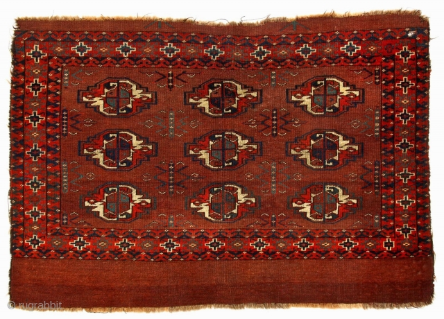 An early Yomut-family chuval with elegant features signifying an early date, c 1850, Symmetric knot, generous spacing of large guls, delicate and unusual tchemche variant secondaries, floating motifs separated from inside borders  ...