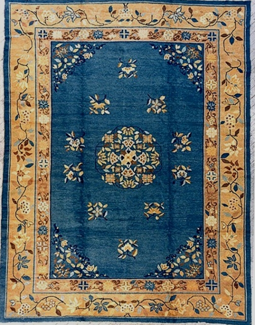 From the estate of a friend, a lovely antique western China/Mongolian carpet, approx. 9x12 feet, c. 1900-20, with pale blue ground and cotton foundation. Bold decorative undulating vine border in attractive harmonious  ...