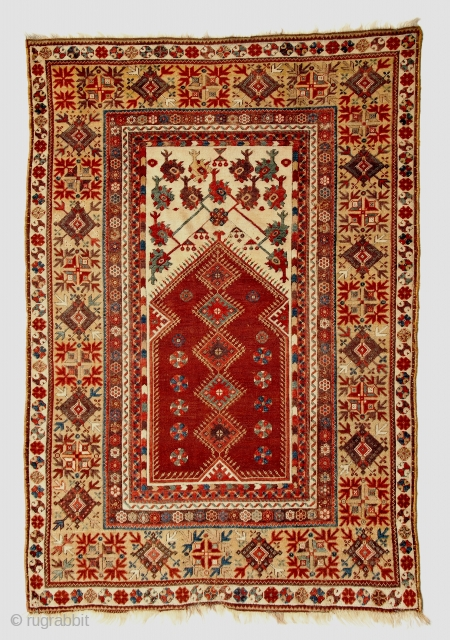 Uncommonly fine Classic Anatolian Milas prayer rug, refined drawing and harmonious palette including a luscious aubergine. 44 x 64 inches (112 x 163 cm). No restoration, sides wrapped, great plush texture with  ...