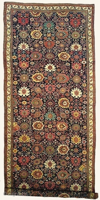 An important N.W. Persian carpet, measuring 9.6 x 23.3 feet (2.90x7.10m). Woven near the end of the Zand or beginning of the Qajar Dynastic periods, ca 1775-1800. Of the same heritage and  ...