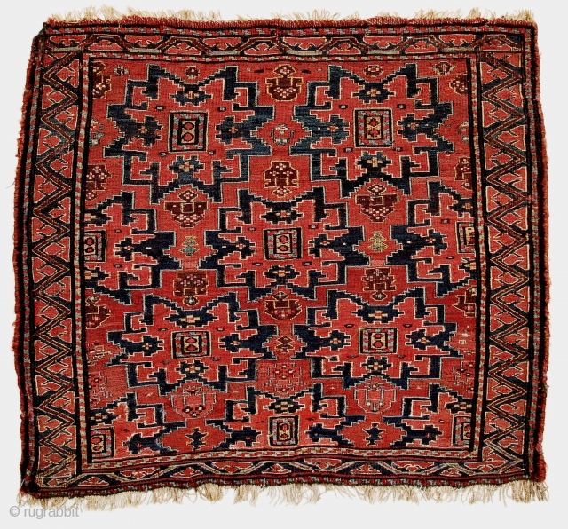 "Highly unusual sumak khorjin face, circa 1875, displaying ""Lesghi"" medallions overall on a dramatic red ground. THe white strip is Velcro loosely stitched for mounting on the wall. It will be easily  ..."