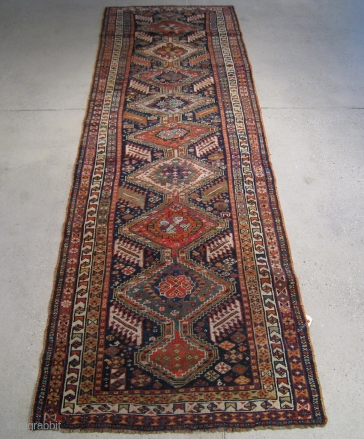 "A Late 19th Century Q'ashqa'i Runner, 8' 8"" x 2' 8""."