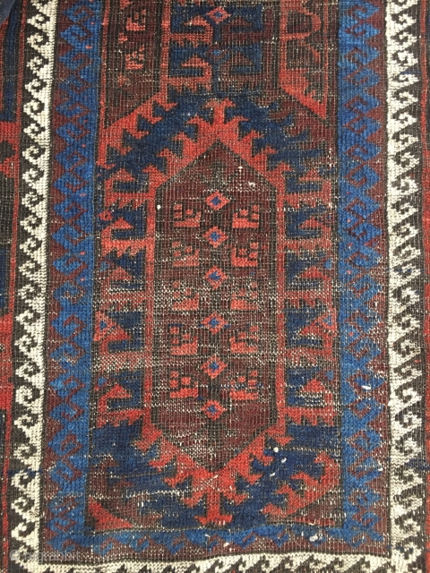 "Electric blue Baluch with graphic large scale design. 58"" X 33."" Sides are 100% good! Wear. Inexpensive."