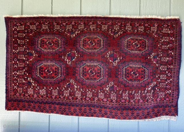 """Antique Tekke Chuval: very finely knotted and fine detail. Intense color including cochineal based. One synthetic red which hasn't affected adjacent colors. 47"""" x 27"""". Good condition with some areas of lower  ..."""