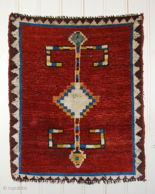 Beautiful totemic small Gabbeh, 27 x 32 inches/67 x 80cm, circa 1900, natural dyes, multiple wefts, some red in the field mixed: very slightly tip faded; very good condition ,even middle high  ...