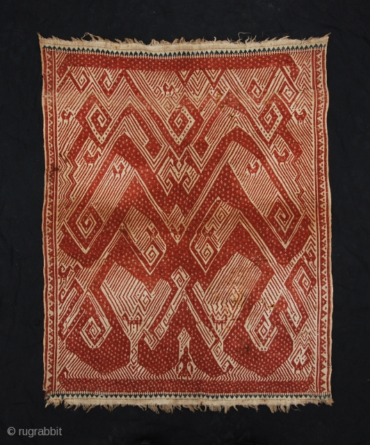 Tampan with unusual design: a single human like figure on a boat with above a dynamic atmosphere with spirals and animals (birds). It's a ceremonial textile from Sumatra. 19th century. Size 65  ...