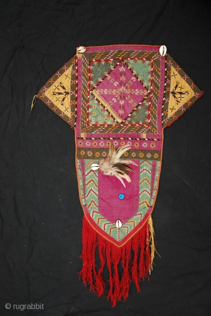 Very fine Tekke Turkmen embroidered camel head cover. Wedding trapping. Rare with Kauri shells, blue beads and feathers still attached. All natural colors. Good condition. For more details, please ask.