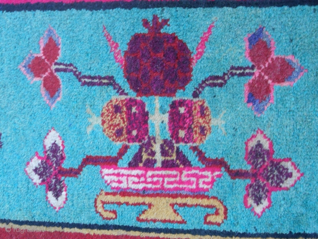 cm. 270 x 150 KHOTAN with an original design. A central panel with a design of a Samurai. Border vase design. This is an interesting piece very original for the XINJIANG region.  Perfect condition, washed and  ...