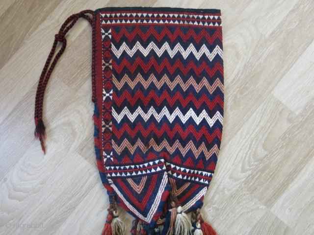 "Turkmen Yomud okbash. Circa 1900 or earlier. Natural colors. Good condition.   Height: 56 cm x width: 33 cm (22"" x 13""). Tassels: 46 cm (18"")."