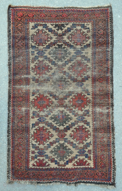 Small Baluch rug with Camel ground - worn but interesting - 2'3 x 3'9 ft. - 69 x 114 cm.