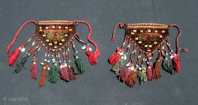 "Pair of Baluch camel knee covers or ""dizlik"".  7 X 8"" exclusive of tassels.  Good condition, even pile, tassels intact and decorated with shells and beads.  No holes or  ..."