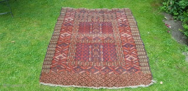 An Antique Tekke Ensie rug. Some light wear. 4ft6x3ft10. 19thc .
